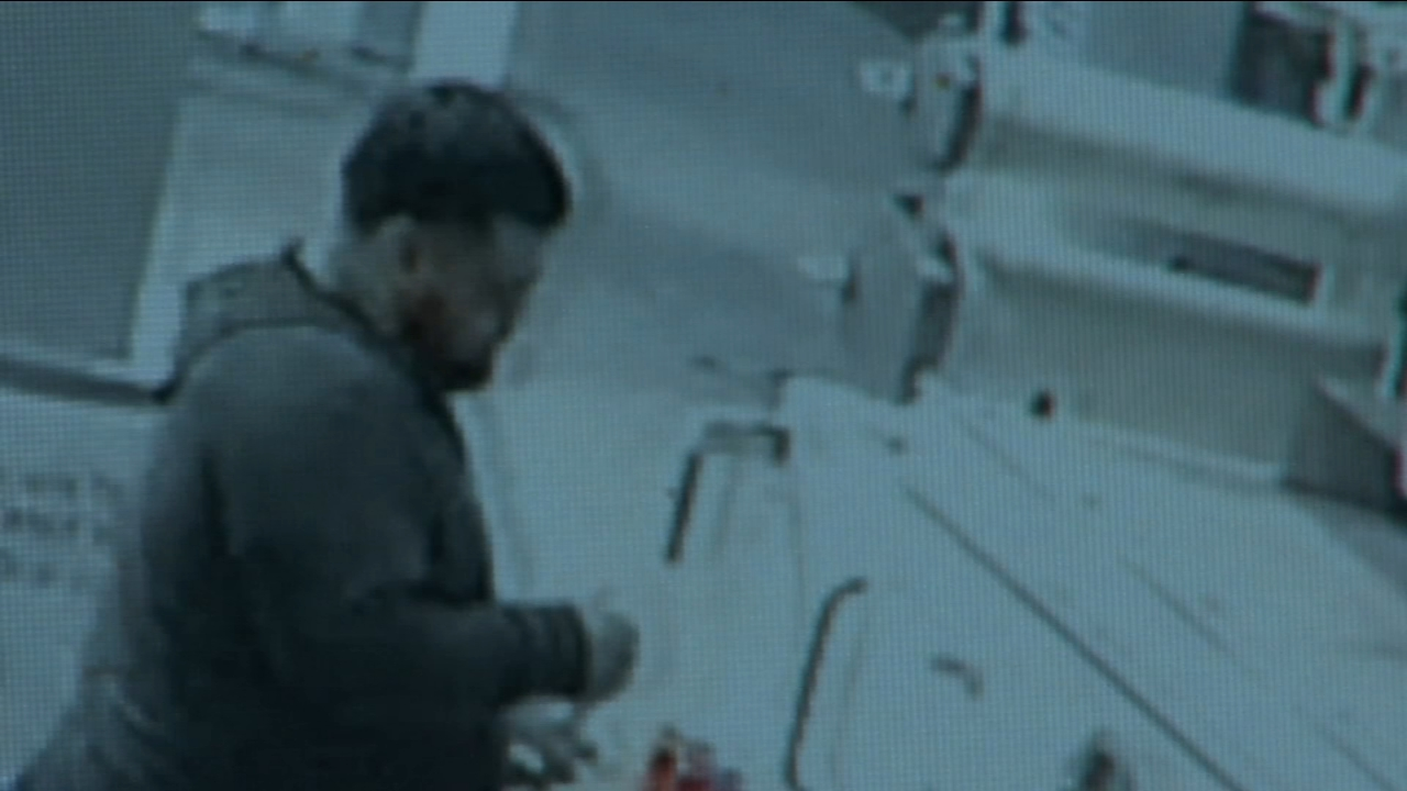 The suspect seen in a surveillance video is accused of taking the entire credit card reader at a pump of a gas station.