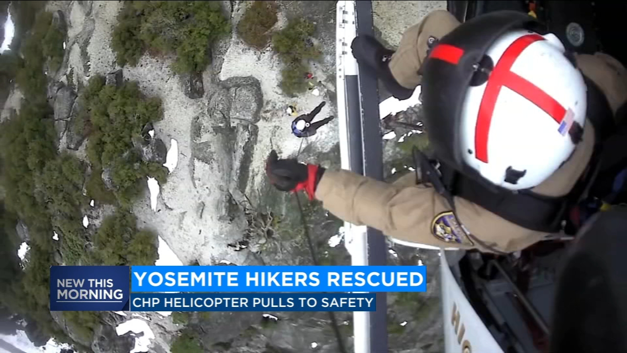 Video of the rescue shows a CHP helicopter crew plucking two hikers off the edge of a massive granite cliff overlooking Yosemite Valley.