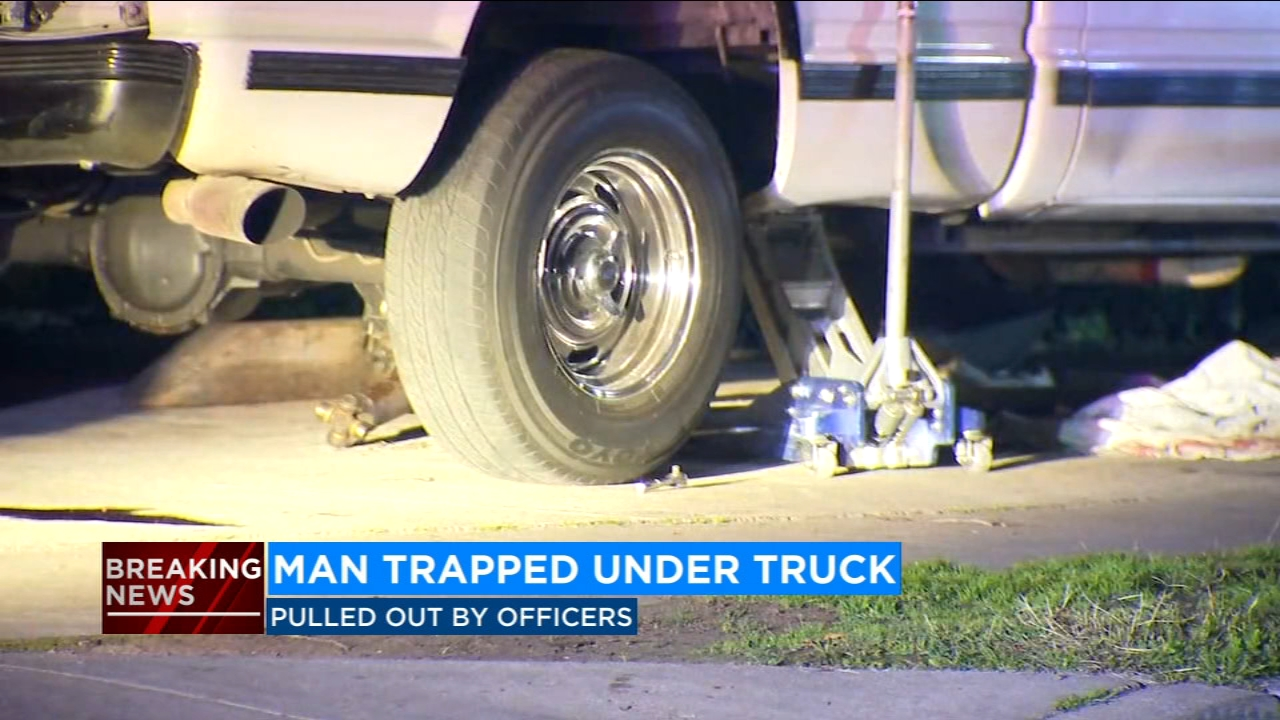 Man trapped under truck while working on it; Parlier police rescue him