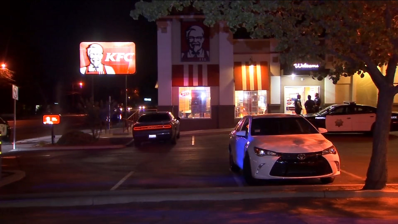 Fresno Police are searching for an armed robber who stormed into a Kentucky Fried Chicken store near Dakota and West in Central Fresno on Thursday evening.