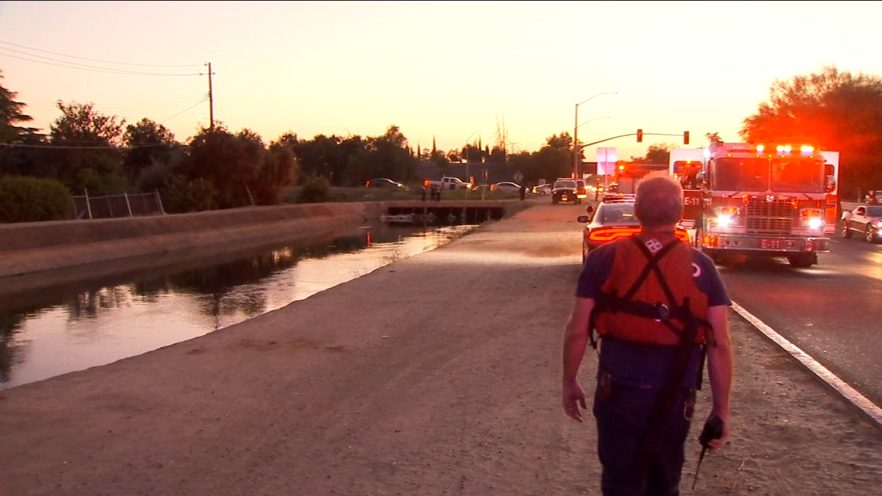 Police are investigating the cause of death after a body was found floating in a Central Fresno canal.