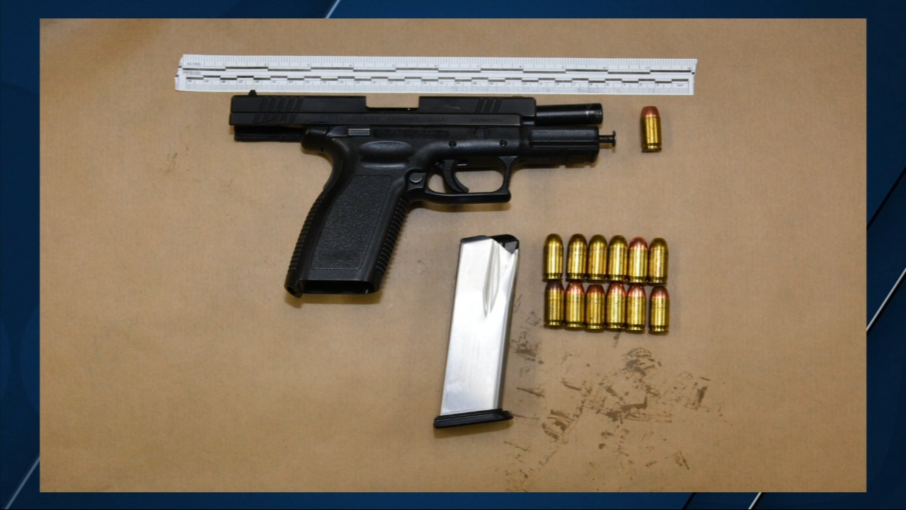 Three suspects are in custody after police pulled them over and recovered two stolen handguns in their vehicle.