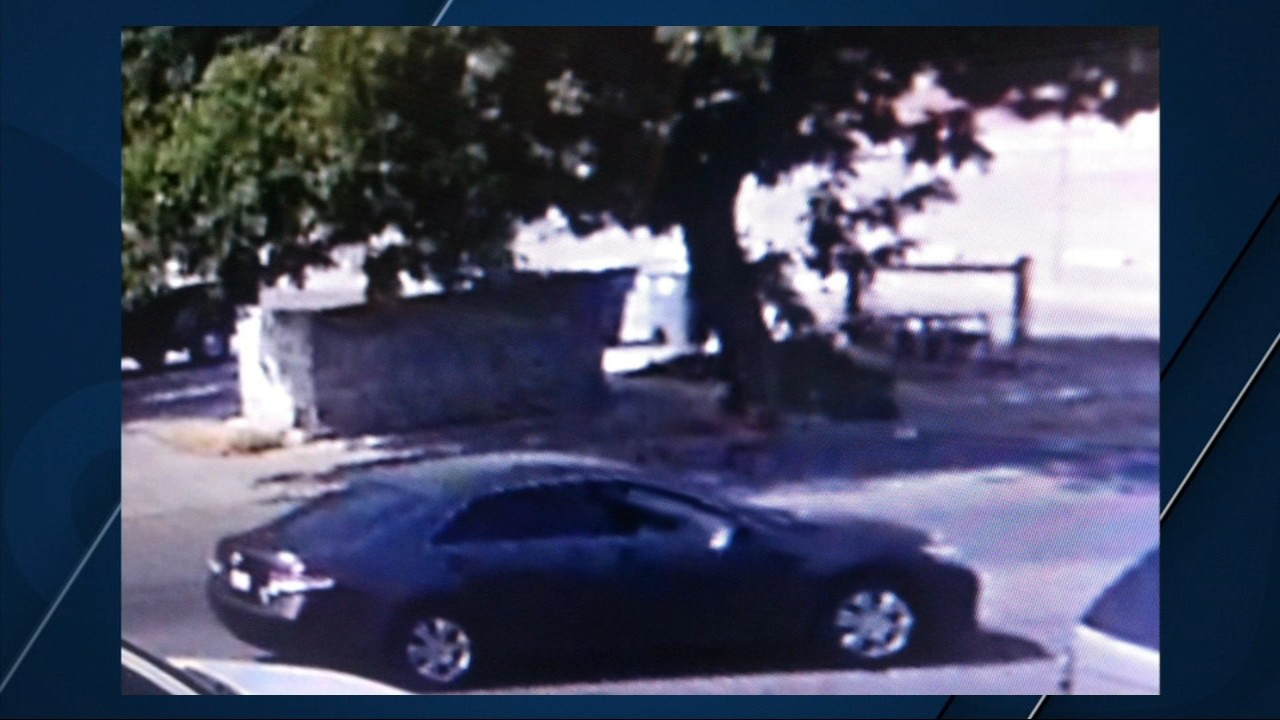 Surveillance video shows people inside two cars opening fire near 4th Street and Forest Avenue.