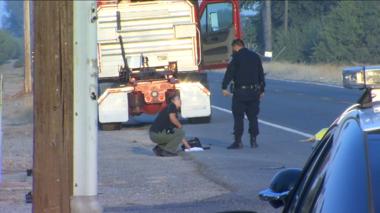 A woman is dead and a man is being treated at the hospital after they were hit by a semi-truck.