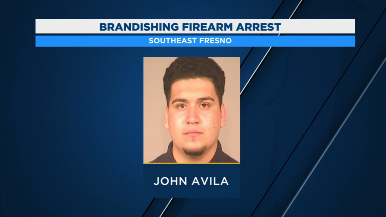 A suspect is in custody after being accused of brandishing a firearm at a driver in Southeast Fresno.