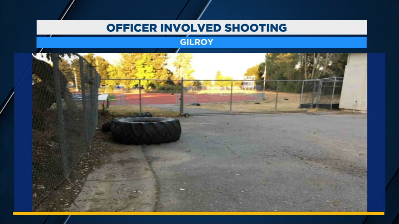 A Gilroy police officer shot at a man he says was trying to run him down in a field not far from where kids played youth football.