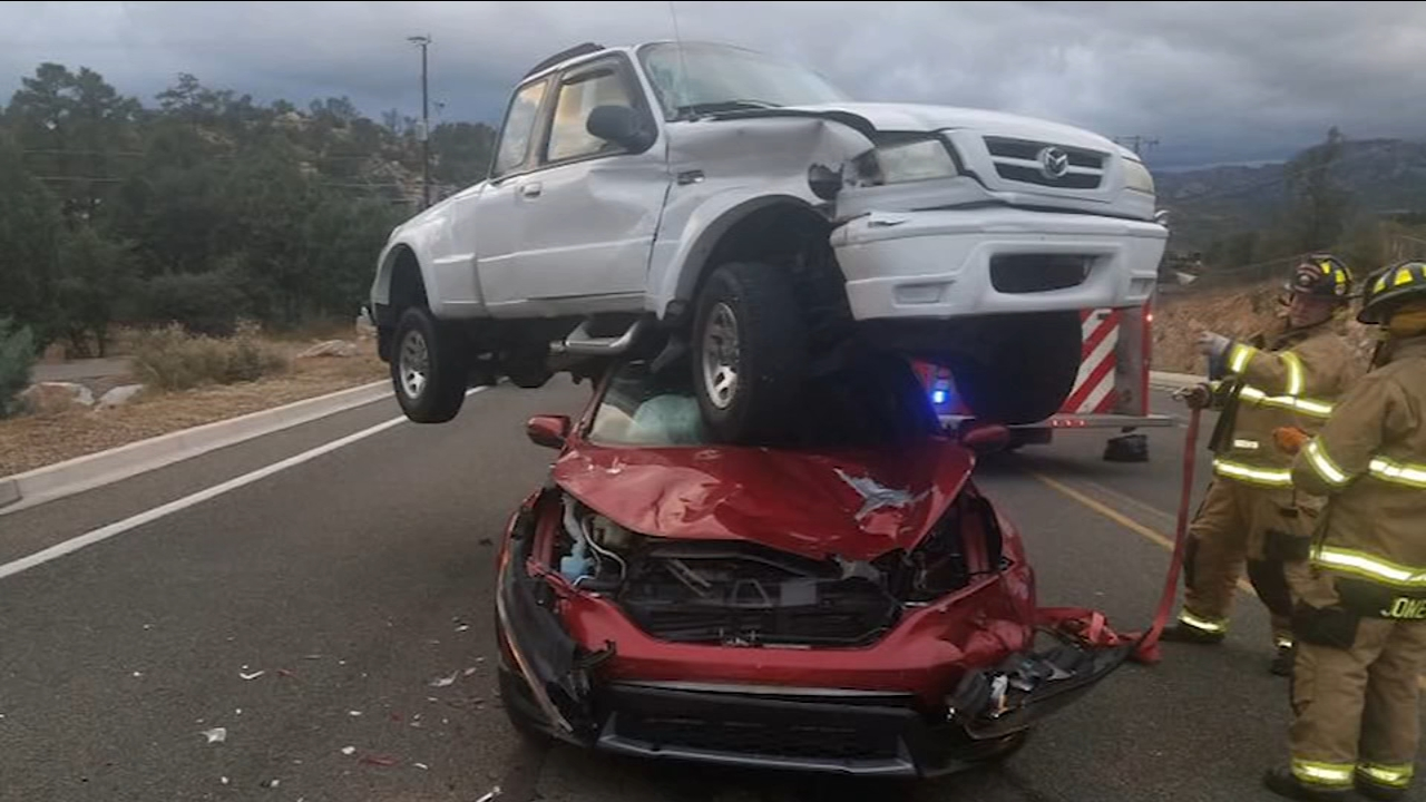 The woman driving the white pickup told authorities a truck traveling in the lane next to her, hit her truck and caused her to lose control.
