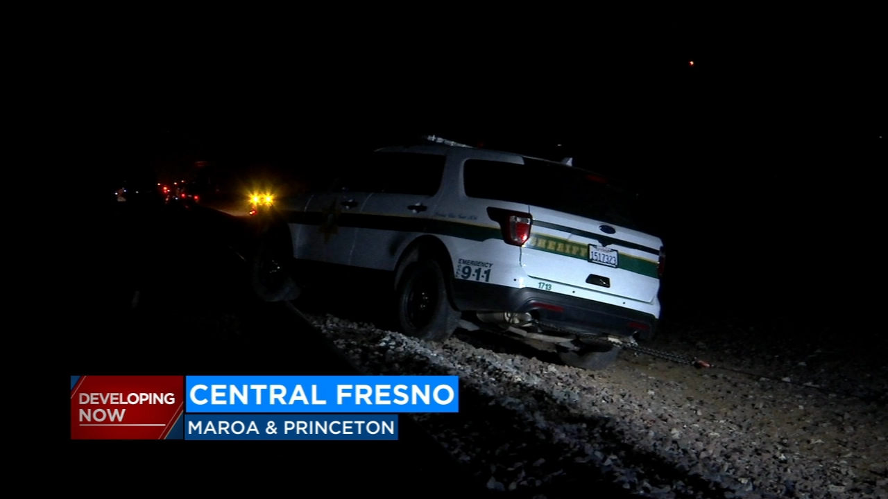 Both the suspect and a sheriffs deputy in training got their vehicles stuck on the train tracks at the end of the pursuit.