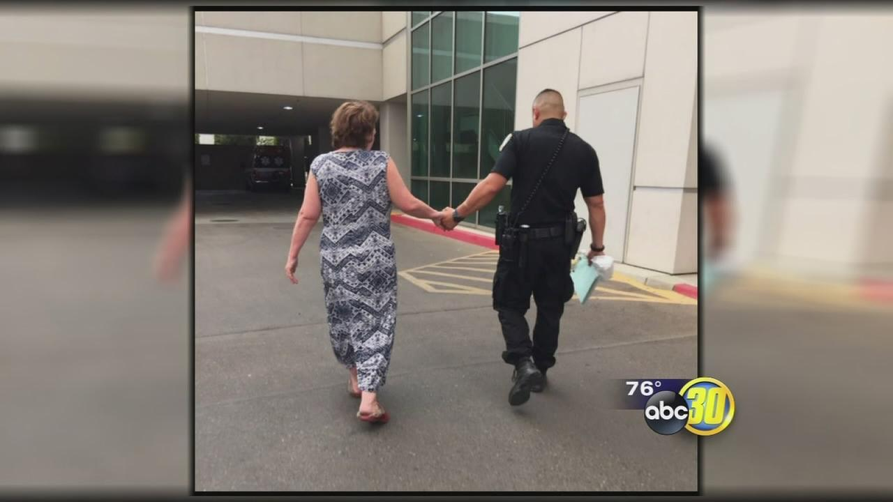 Visalia Police Department goes viral after photo of officer lending a helping hand