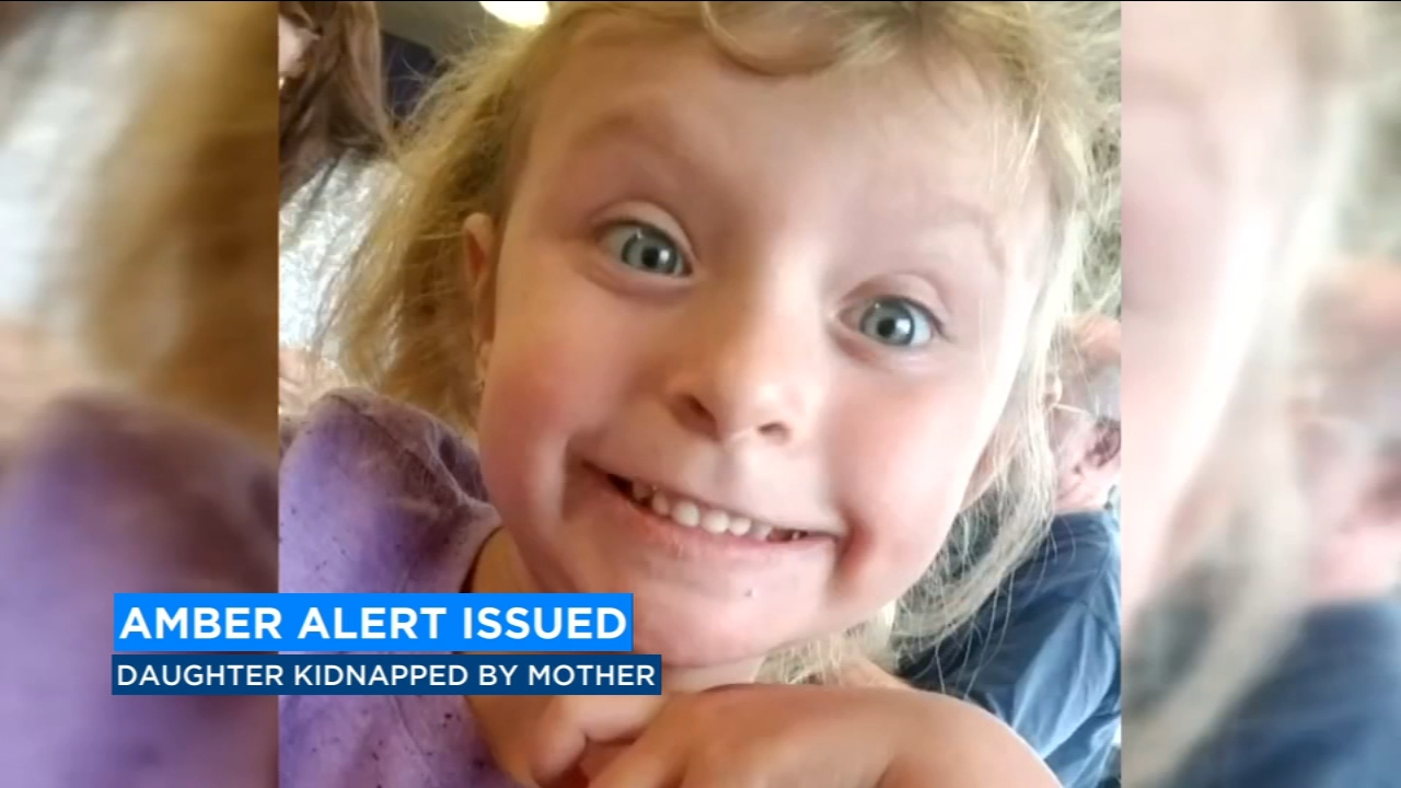 Officers are searching for a woman who is accused of kidnapping her four-year-old daughter from a social worker.