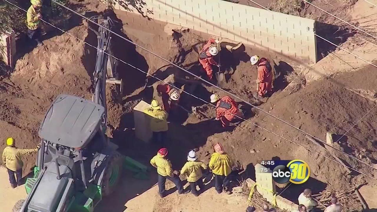 Body found in car buried in mud