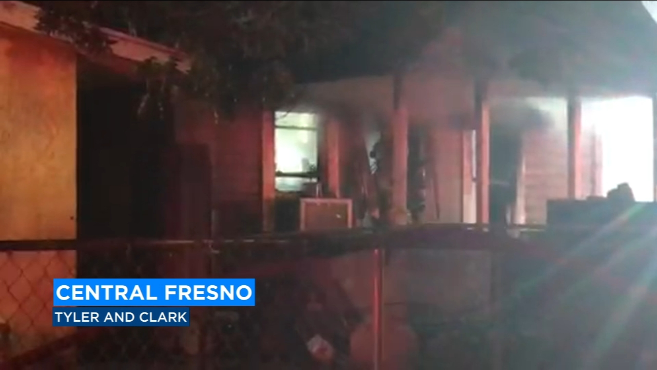 A two-alarm house fire in Central Fresno early Sunday morning forced 14 people out of their homes, including nine children.