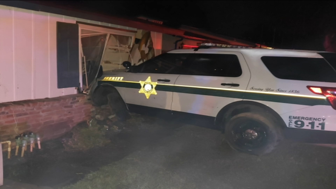 The deputy was chasing a suspect and lost control of his car, crashing into the house.