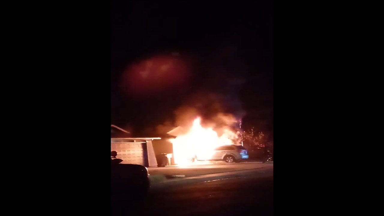 Fire tears through SUV nearly reaching home in Visalia
