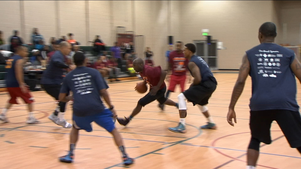 Fresno Police officers traded in their badges for some basketball shorts Wednesday night during the Nothing but Net community basketball game.