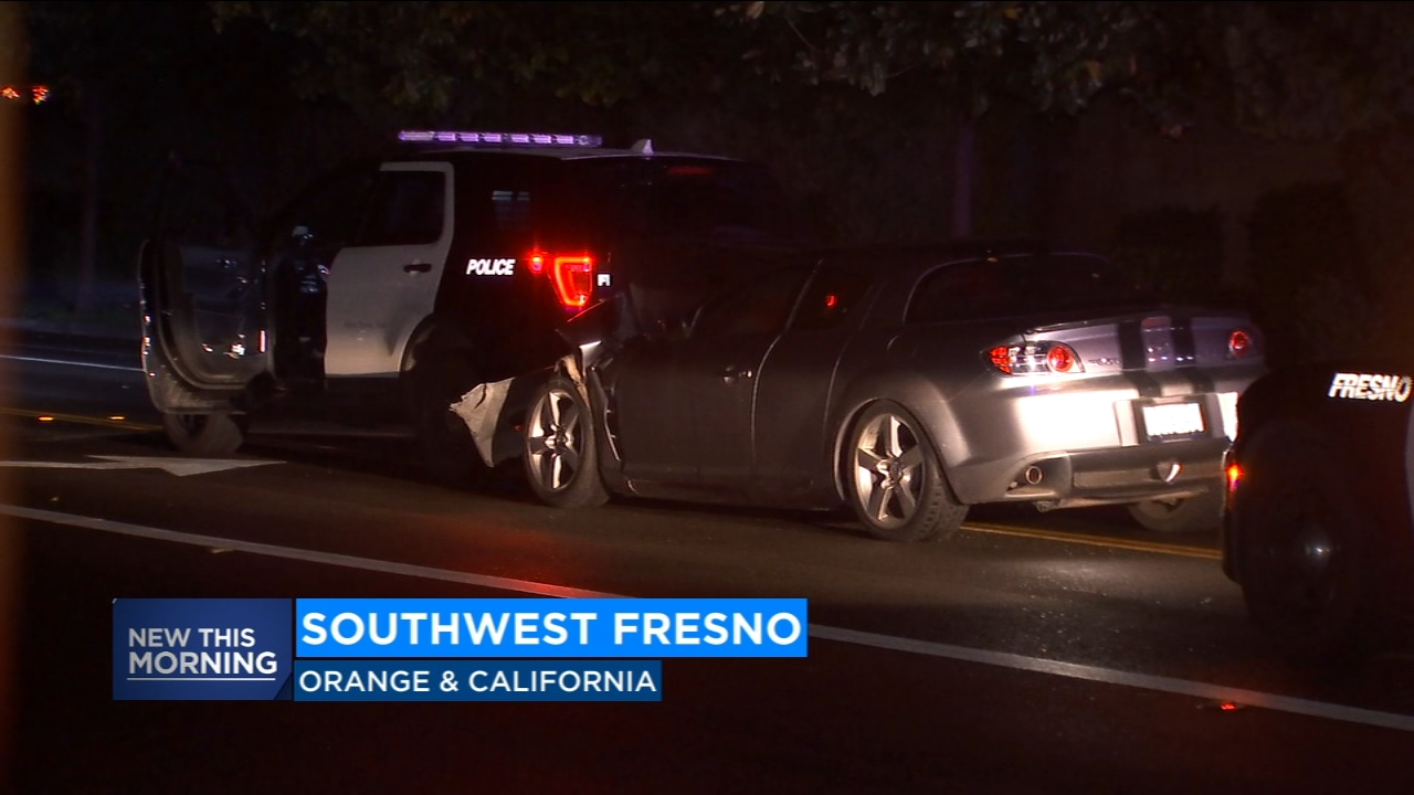 A man has been detained after crashing his car into the back of a Fresno Police car.