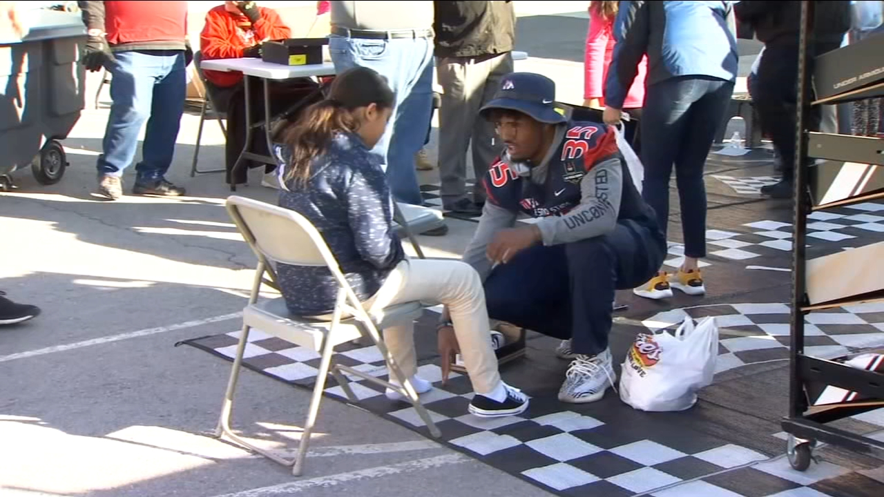 More than 700 kids felt the holiday spirit at an elementary School in Las Vegas during the 10th annual Goodie Two Shoes event in partnership with the Las Vegas Bowl.  More than 7