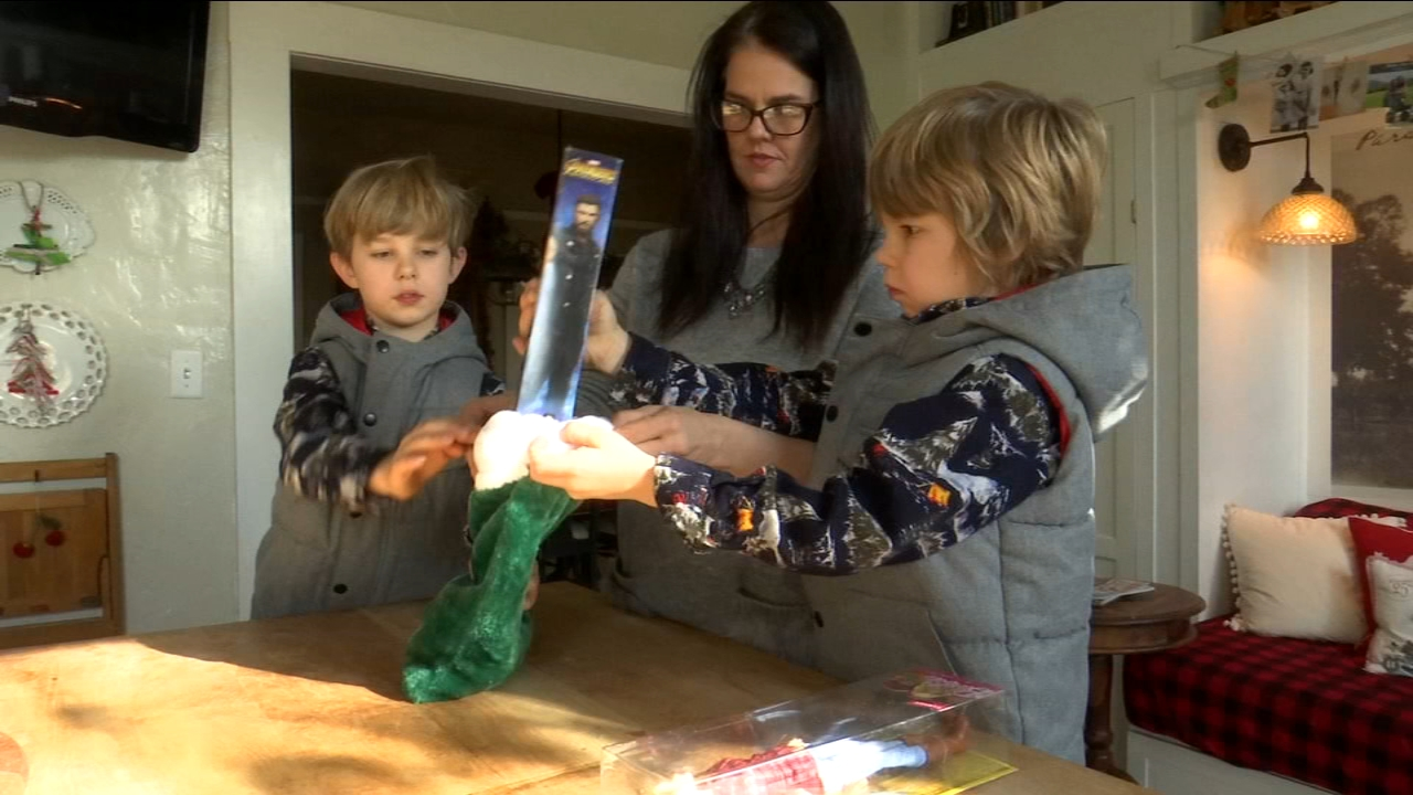 Chris, Amie and their two youngest boys are stuffing stockings that will go directly to people whove been impacted by the Camp Fire.