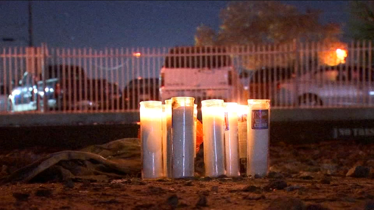A candle lit memorial, sitting along the railroad tracks at Diana and Belmont Avenues shines light on a life taken too soon.