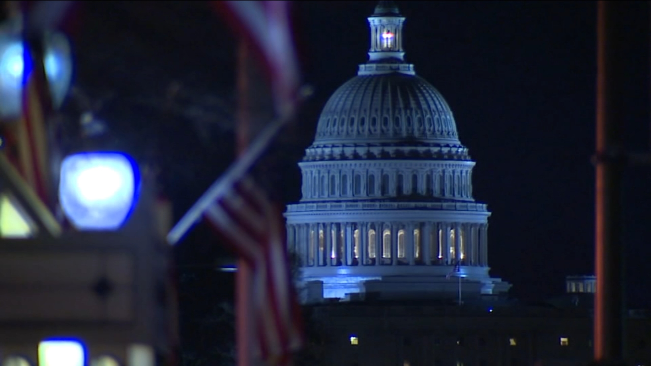 The Senate approved legislation Wednesday to temporarily fund the government, a key step toward averting a federal shutdown after President Donald Trump backed off his demand for m