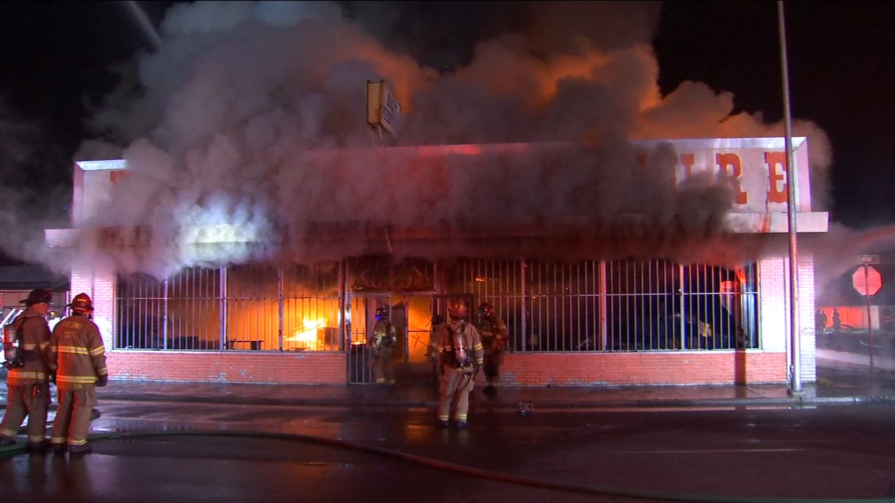 Flames ripped through what used to be Halls Furniture in Central Fresno.
