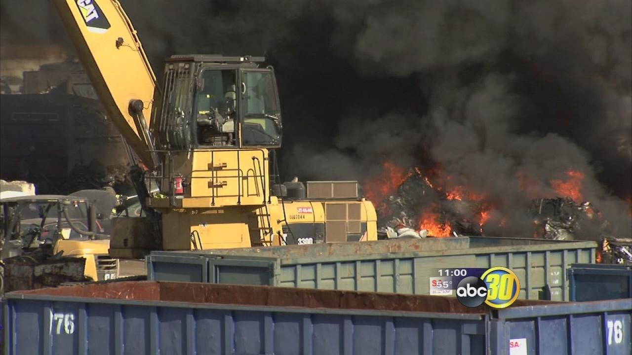 Large fire burns vehicles at a recycle yard south of Fresno