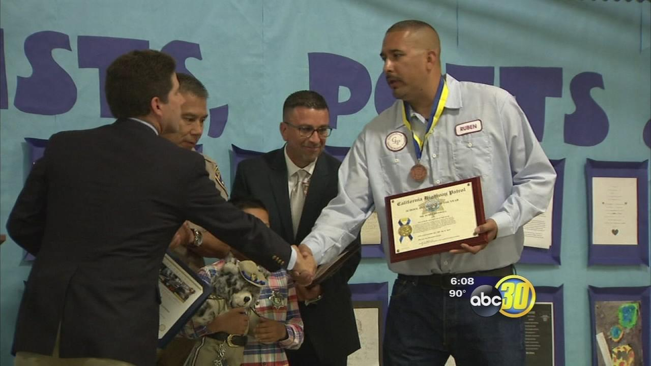 Fresno bus driver honored for rescuing boy from dog attack