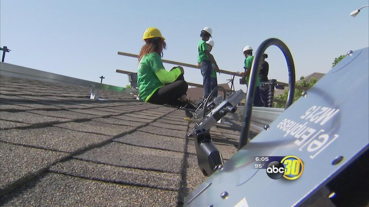 Group of Fresno Unified students getting hands on trade experience while serving the community