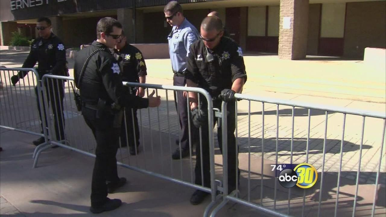 Police and workers prepare Downtown Fresno for Trump rally