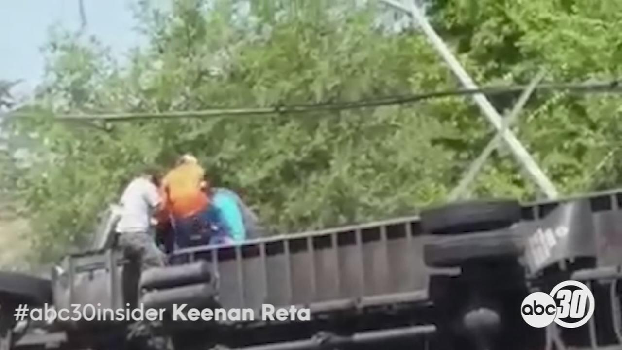 Bystanders rescue truck 2 from overturned truck in Fresno