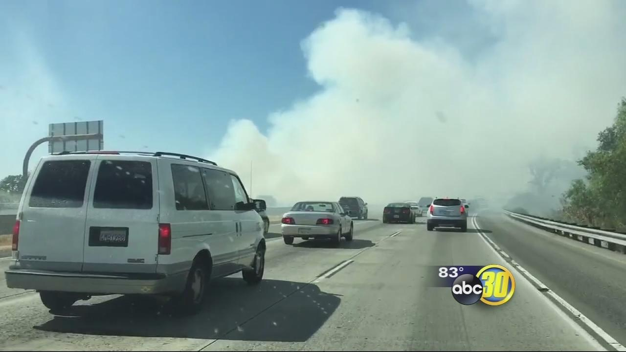 Thick smoke from fire burning along Hwy 41 created hazard for drivers