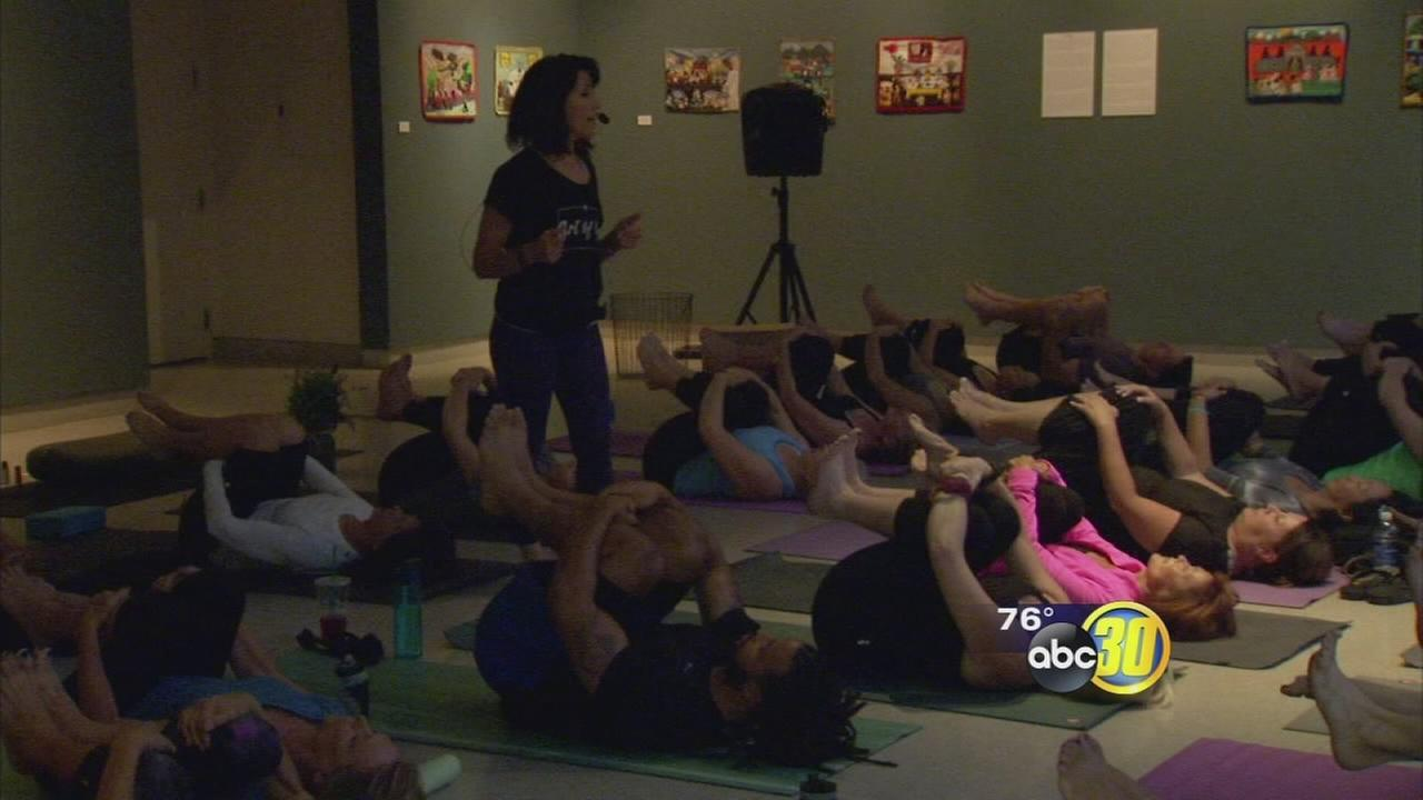 Nearly 100 people show up at Fresno Art Museum for yoga class benefiting cancer foundation