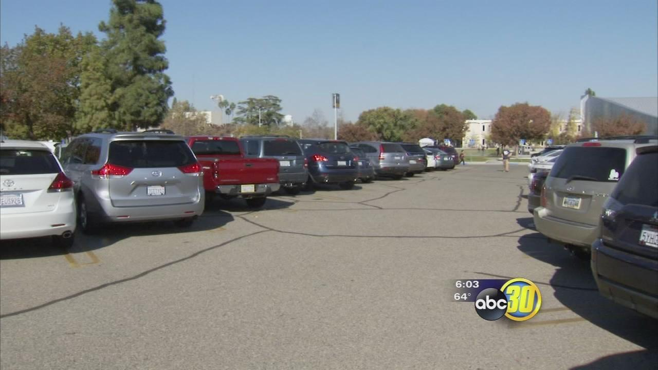 Fresno State professor has car stolen by two armed men