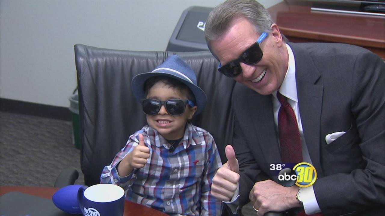 Three-year-old Elijah Urquizo gets a new pair of ABC30 sunglasses