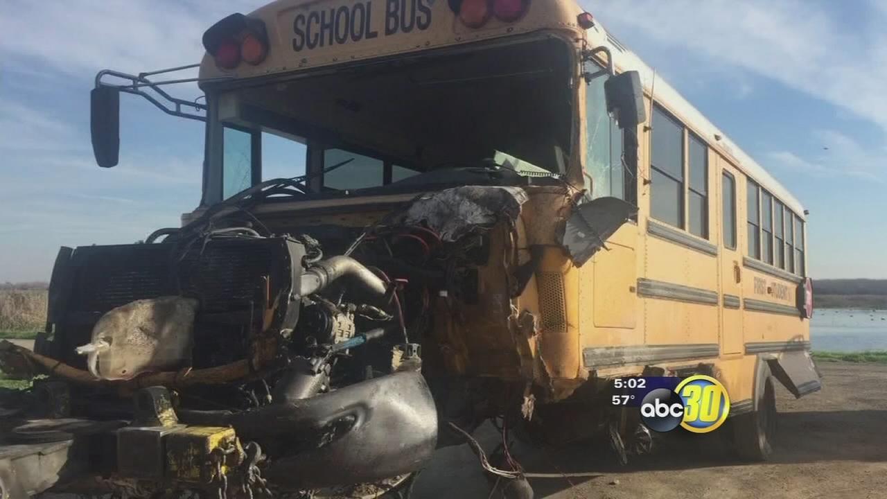 1 killed in school bus and van head-on crash near Stevinson, CHP says