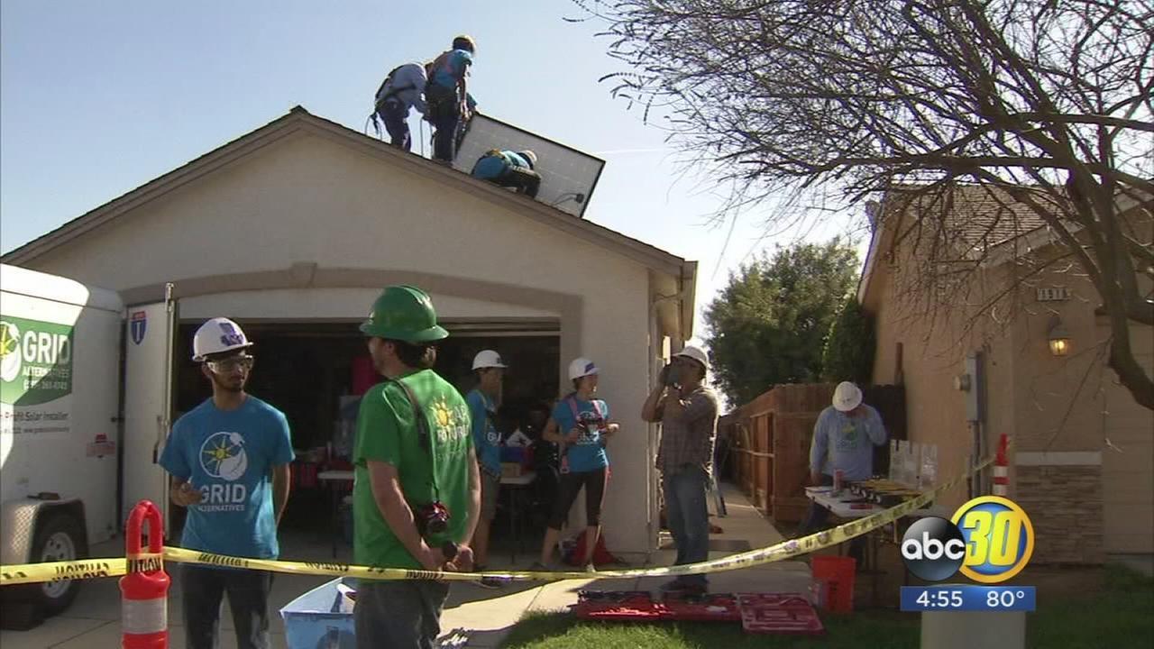 Students spend spring break installing solar panels for Fresno families