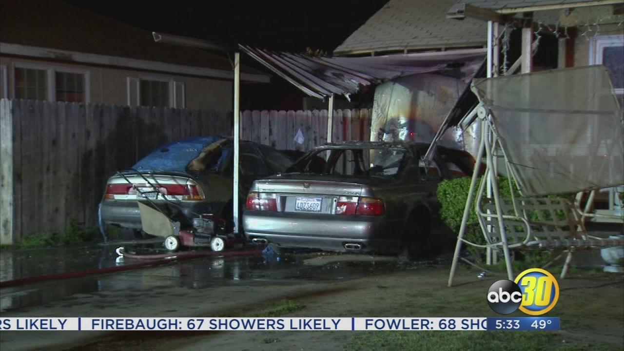 Fresno firefighters save home after car, carport fire