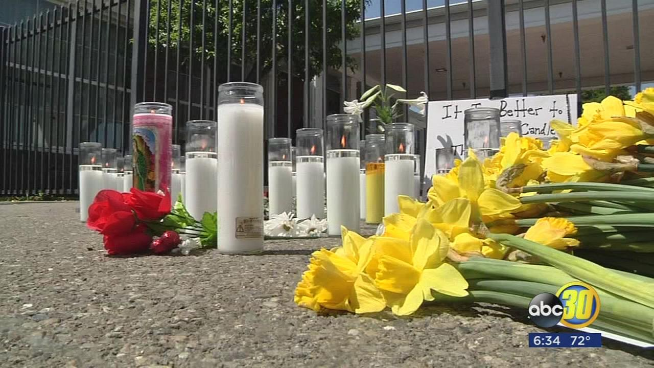 Growing memorial in the streets of Central Fresno after shooting spree