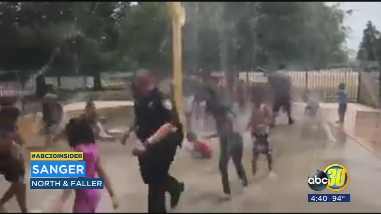VIDEO: Sanger Police Officers having fun and keeping cool with kids at Splash Pad