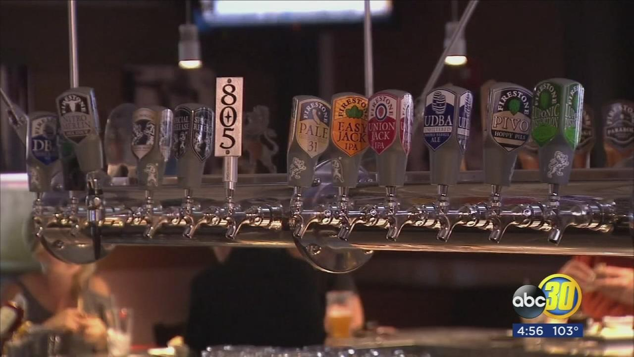 People escaping the heat at Paso Robles brewery with beer tastings