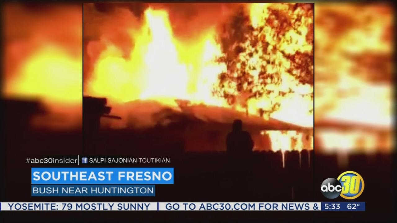 Viewer video shows massive flames as fire rips through Southeast Fresno home