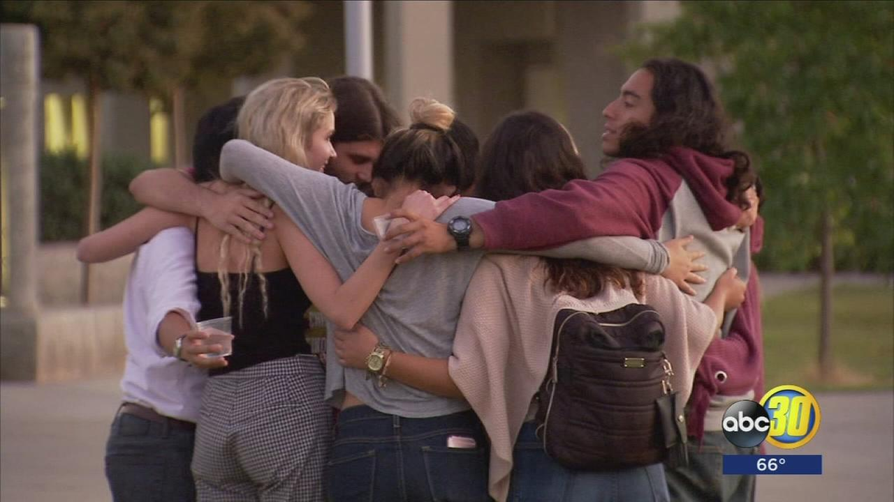 Candlelight vigils flickered across the Valley to honor Las Vegas victims