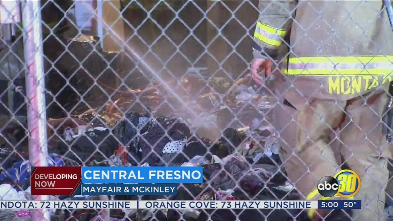Fire crews put out fire behind Disabled American Veterans Charities thrift store in Central Fresno