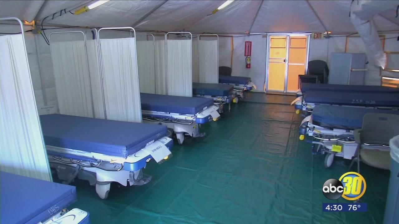 Busy Kaweah Delta ready to use second tent to triage patients