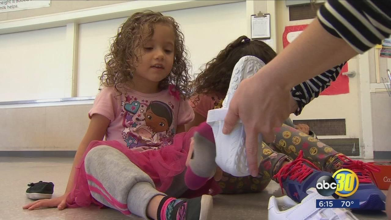 Students at Kirk Elementary School receive new shoes