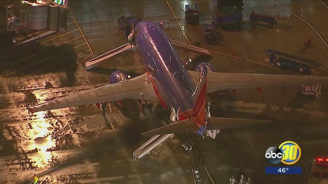 Airplane evacuated at John Wayne airport with smoke showing