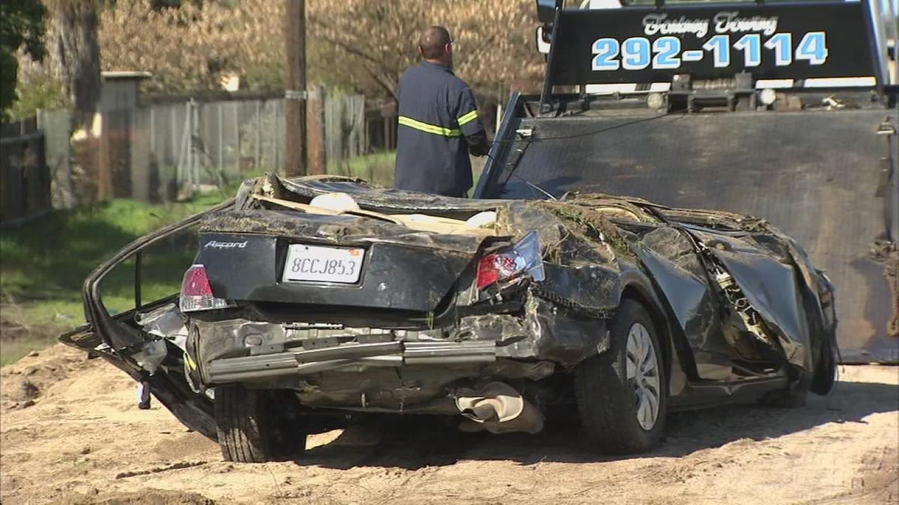 Car flys over canal and fence into backyard of Central Fresno home, 1 man killed and 1 hospitalized