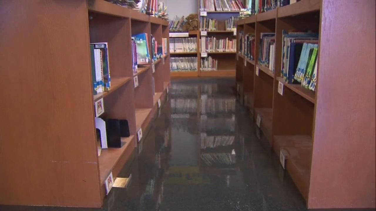 Cleanup after rains flood Planada Elementary