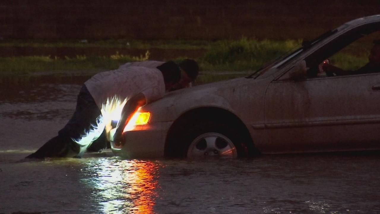 Storm damages vehicles, roadways