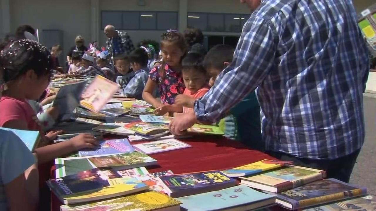 Planada students surprised with new books after storm flooded library
